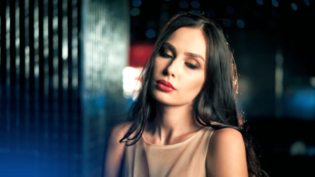 Fashion elegant woman model in beautiful dress posing over glowing night background video