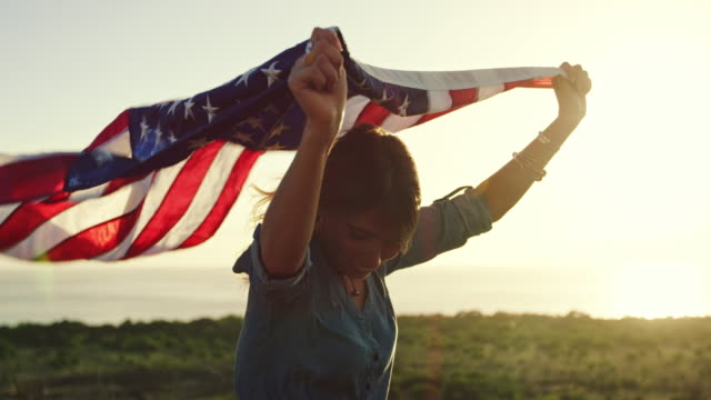 Fashion Lifestyle of Young Woman Beautiful young woman at with American flag at sunset, fashion lifestyle happy 4th of july videos stock videos & royalty-free footage