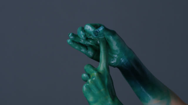 fashion model`s hands painted green shows gestures. fashion video. - palm of hand stock videos & royalty-free footage