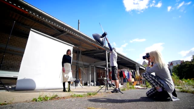 Fashion photo shooting outdoors in friendly and relaxed atmosphere video