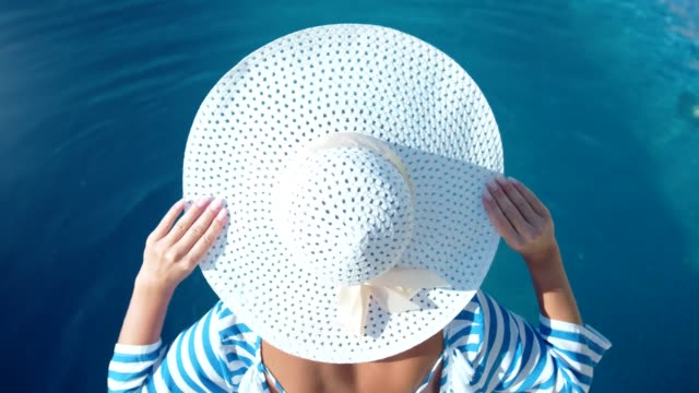 fashion pretty woman wearing white elegance hat and enjoying sunbathing at summer vacation - cappello video stock e b–roll