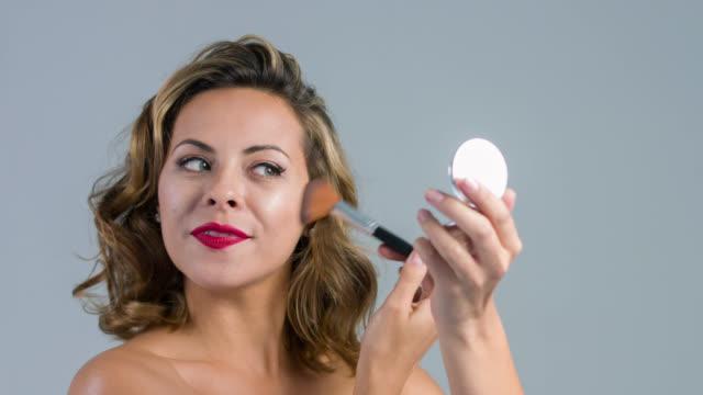 Fashion woman applying make up video