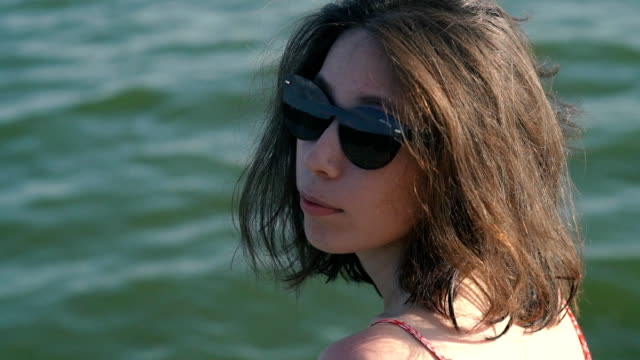 Fashion Woman In Sunglasses With Beach Reflection