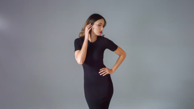 Fashion woman posing for he camera Asian fashion woman in a little black dress posing for the camera - beauty concepts dress stock videos & royalty-free footage