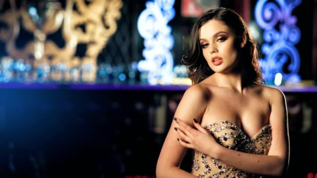 https://media.istockphoto.com/videos/fashion-young-women-posing-in-beautiful-dress-video-id874364124?s=640x640