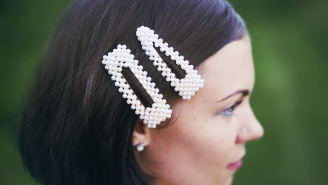 Fashionable hairpins. Woman clip pearl barrettes. Concept of fashion, hairgrip, trends.