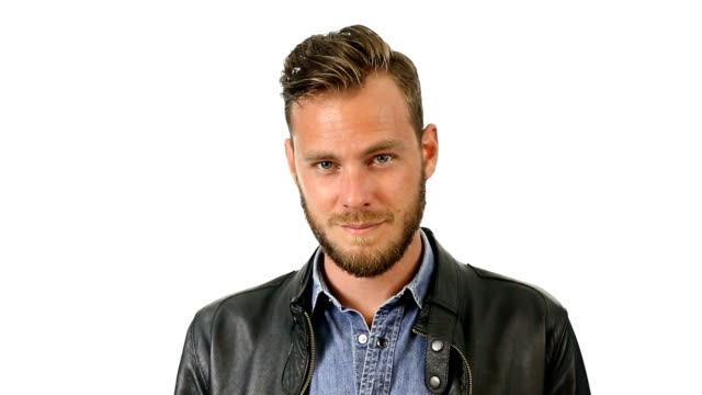 Fashionable man in his 20s against white background video