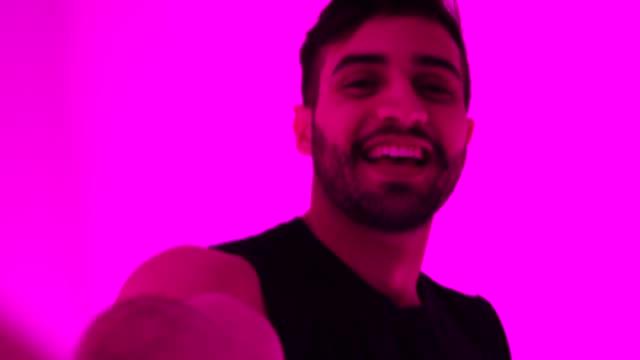 fashionable man taking a selfie at colorful tunnel - kultura młodości filmów i materiałów b-roll