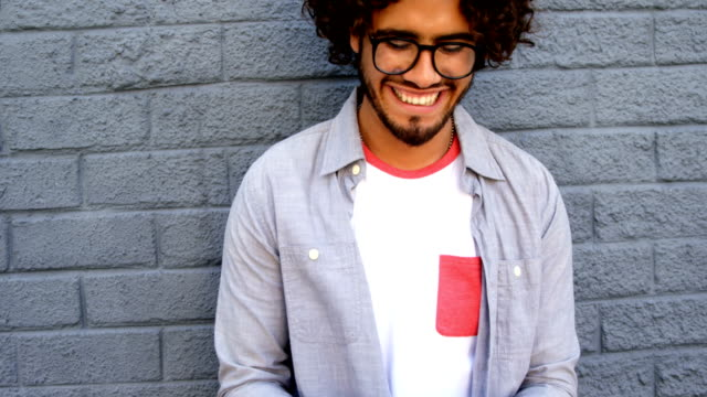Fashionable man using smartphone video