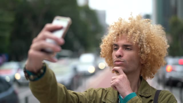 Fashionable Men with Curly Hair Taking a Selfie Alternative Lifestyle vanity stock videos & royalty-free footage