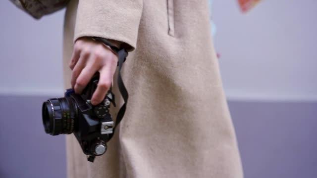 Fashionable traveling female photographer