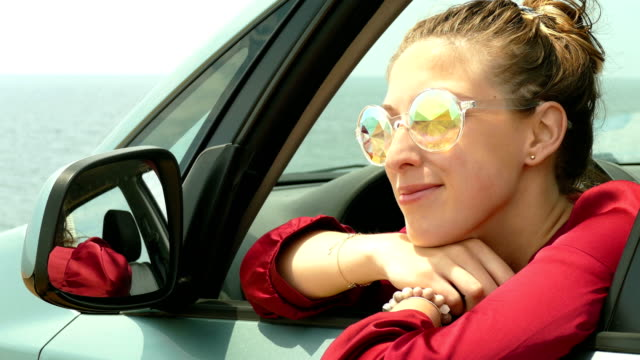 fashionable young woman in sunscreen in a car on the coast - eastern european descent stock videos & royalty-free footage