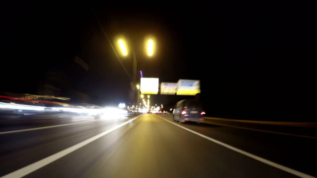 Fast City Drive night road POV through city at night timelapse video