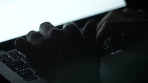 Fast computer laptop keyboard typing at night Fast computer laptop keyboard typing at night dolly shot stock videos & royalty-free footage
