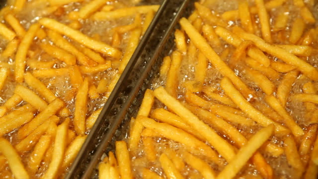 fast food french fries in restaurant deep fryer - junk food stock videos and b-roll footage