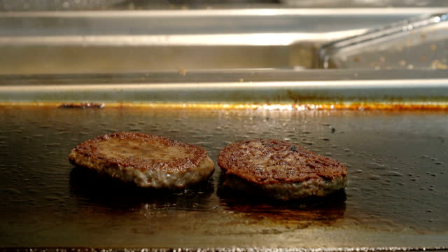 fast food kitchen: fryer and grill for hamburger video
