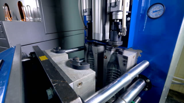 Fast motion captures blow-molding process in detailed view. video