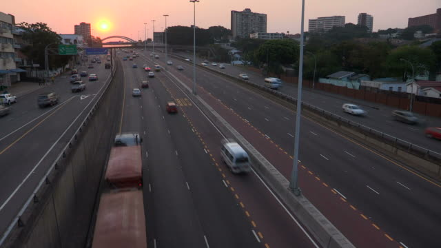 Fast motion traffic on Durban highway. Speed-ed up traffic coming in both directions on a busy Durban highway at sunset. south africa stock videos & royalty-free footage