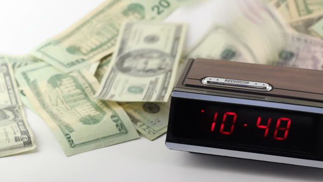 Fast Moving Digital Time Clock and Falling Paper Money video