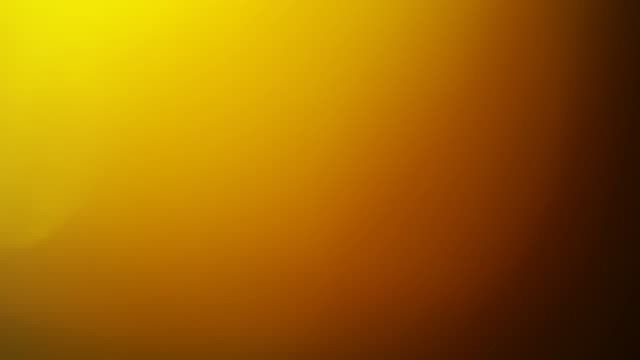 Fast Orange Light pulses and glows. Beautiful light leak in warm hue on dark background with