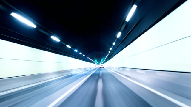 Fast traffic in tunnel of modern city, time lapse. video