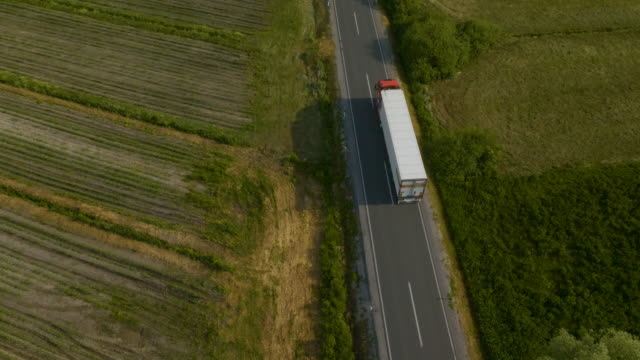 fast truck on the road on its way to town - lungo video stock e b–roll