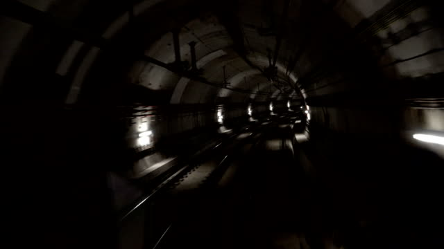 Fast underground train riding in a tunnel of the modern city Fast underground train riding in a tunnel of the modern city 天の川 stock videos & royalty-free footage