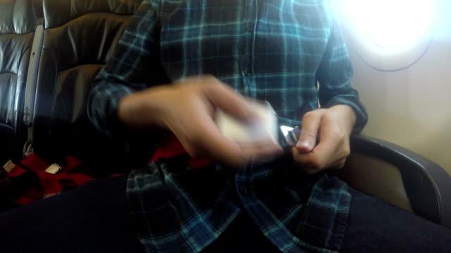 Fastening Seatbelt on Airplane video