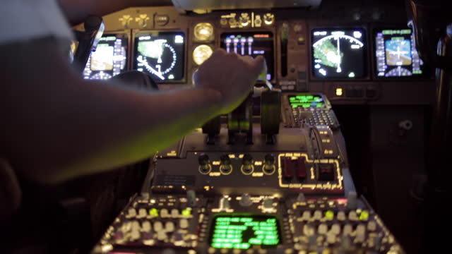 Fast-moving hand-held clip of airline pilot's hand using throttle video