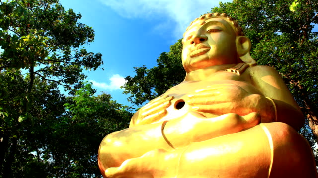 Fat Buddha image Time Lapse Fat Buddha image in blue sky Time Lapse. buddha stock videos & royalty-free footage