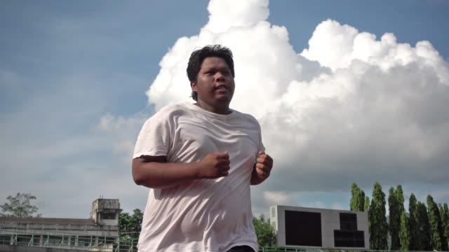 ジョギング デブ男 - 肥満点の映像素材/bロール