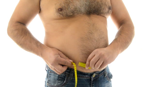 Fat man measuring his belly with measurement tape video