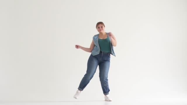 Fat woman dancing in studio