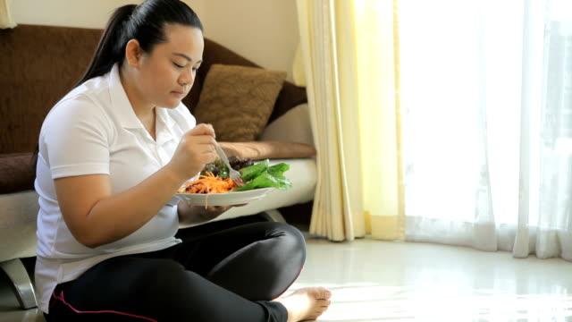 Fat woman eating salad video