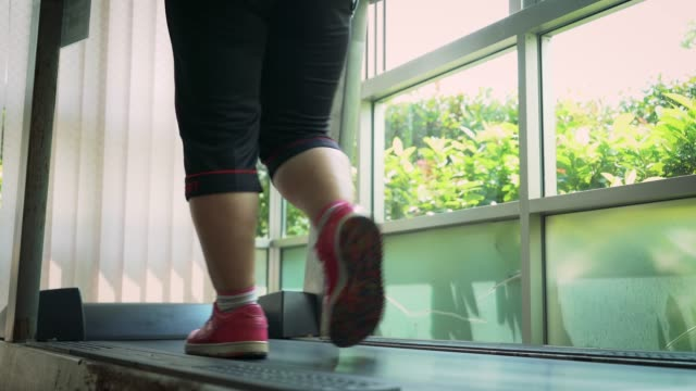 fat woman running on treadmill - runner rehab gym video stock e b–roll
