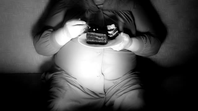 Fat woman watching TV show at night video