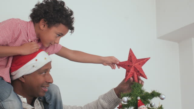 Father and child decorating the christmas tree