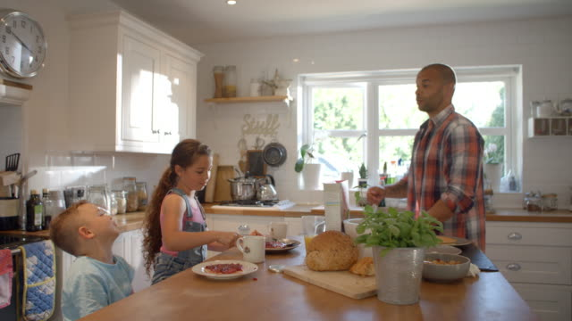 Father And Children At Home Eating Breakfast In Kitchen video