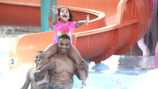 Father and children having fun at water park video