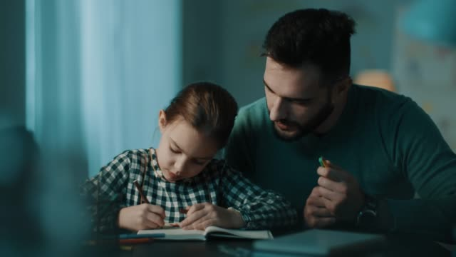 Father and daughter doing homework together video