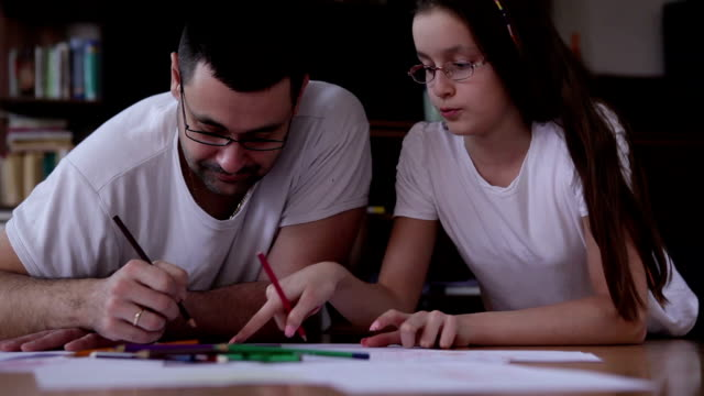 Father and daughter doing homework video