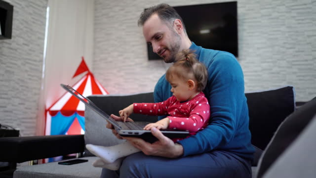 Father and daughter enjoying at home