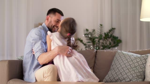 father and daughter tickling and having fun - fare il solletico video stock e b–roll