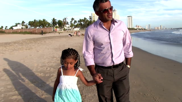 Father and his daughter walking on beach hug kiss video