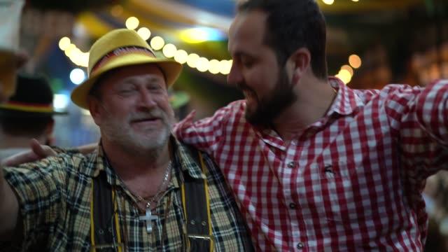 father and son celebrating at oktoberfest in blumenau, santa catarina, brazil - oktoberfest stock videos and b-roll footage