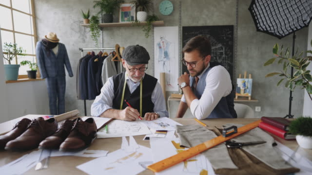 Father and son designing suits together video