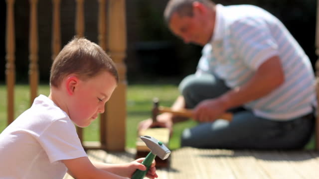 Father and son DIY Father teaching his 4 year old son some DIY skills. chores stock videos & royalty-free footage