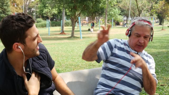 Father and Son listening music and having fun video