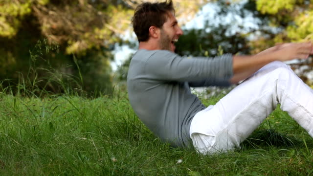 Father and son lying and playing in the meadow video