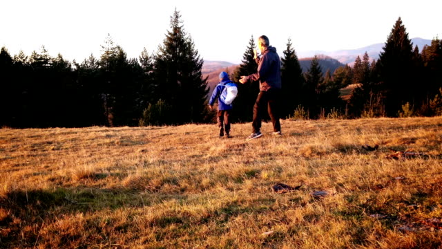 Father and son on a hike, top of the hill in autumn Father and son on a hike, top of the hill in autumn.mov arthropod stock videos & royalty-free footage